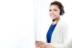 Smiling woman with  headphone as an operator. Smiling woman with  headphone - telemarketer, operator, call center and customer service concepts Royalty Free Stock Photography