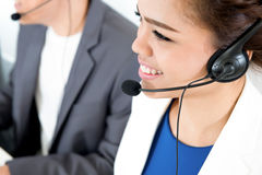 Smiling woman with  headphone as an operator. Smiling women with  headphone - telemarketer, operator, call center and customer service concepts Royalty Free Stock Images