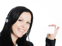Smiling woman with headphone holding busi. Smiling brunette woman with headphone holding businesscard stock images