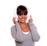 Smiling woman with headphone listening music Royalty Free Stock Images