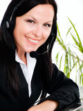 Smiling woman with headphone in office Royalty Free Stock Photo