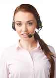 Smiling woman with headphones in Call Centre Royalty Free Stock Photography