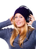 Smiling woman with headphones listening musi Stock Photo
