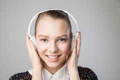 Smiling woman with headphones listening music Royalty Free Stock Photo
