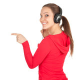 Smiling woman with headphones pointing Royalty Free Stock Image