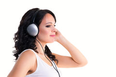 Smiling woman with headphones in profile isolated Royalty Free Stock Photo