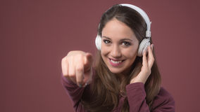 Smiling woman with headphones Stock Images