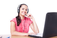 Smiling woman with headset Stock Images