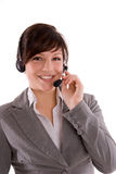Smiling woman with headset. Attractive smiling woman in smart business suit wearing headset with earphones and microphone Royalty Free Stock Photo