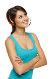 Smiling woman in headset looking up Royalty Free Stock Images