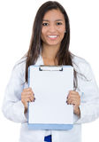 Smiling woman, healthcare professional isolated on white background holding a clipboard with copy space Stock Images