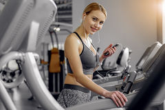 Smiling woman hearing song on treadmill Stock Photography