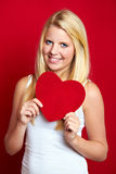 Smiling woman with a heart Royalty Free Stock Photo