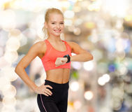 Smiling woman with heart rate monitor on hand Stock Photo
