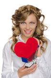 Smiling woman with heart in shopping cart Stock Photography