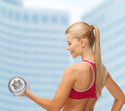 Smiling woman with heavy steel dumbbell Royalty Free Stock Photo