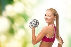 Smiling woman with heavy steel dumbbell Stock Photography