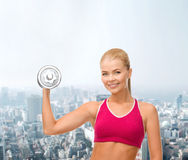 Smiling woman with heavy steel dumbbell Stock Photos