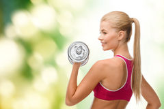 Smiling woman with heavy steel dumbbell Stock Image