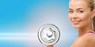 Smiling woman with heavy steel dumbbell Stock Images