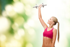 Smiling woman with heavy steel dumbbell Royalty Free Stock Image