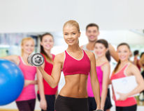Smiling woman with heavy steel dumbbells Royalty Free Stock Photos