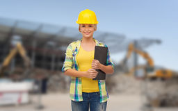 Smiling woman in helmet with clipboard Stock Photos
