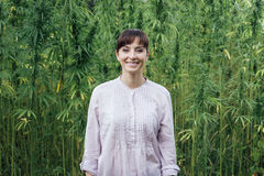 Smiling woman in the hemp field Royalty Free Stock Photography