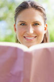 Smiling woman with her book Stock Images
