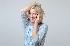 Smiling Woman with her cellphone Royalty Free Stock Photography