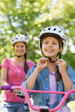Smiling woman with her daughter riding a bicycle Royalty Free Stock Photo