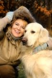 Smiling woman and her dog Stock Photos