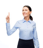 Smiling woman with her finger up Stock Image