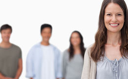 Smiling woman with her friends standing behind her Stock Photo
