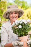Smiling woman in her garden Stock Images