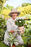 Smiling woman in her garden Stock Photo