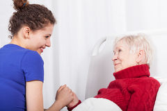 Smiling woman and her granddaughter royalty free stock image