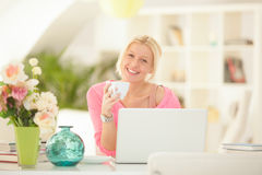 Smiling Woman at Her Laptop at Home Stock Images