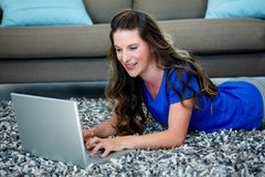 smiling woman on her laptop Royalty Free Stock Photography