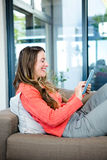 smiling woman on her tablet Stock Photos