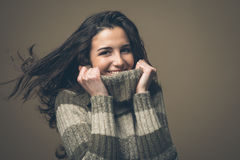 Smiling woman with high collar sweater Royalty Free Stock Images