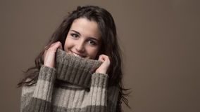 Smiling woman with high collar sweater Royalty Free Stock Photography