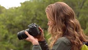 Smiling woman on a hike taking a photo stock video footage