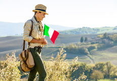 Smiling woman hiker with Italian flag enjoying Tuscany view Royalty Free Stock Images
