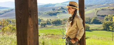 Smiling woman hiker in Tuscany looking into distance Stock Photography
