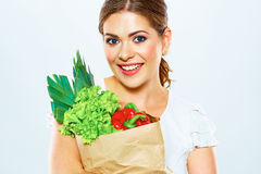 Smiling woman hold bag with green food. Stock Photos