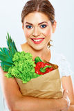 Smiling woman hold bag with green food. Royalty Free Stock Image