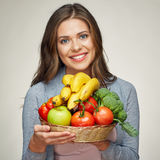 Smiling woman hold basket with healthy green food. Stock Photography