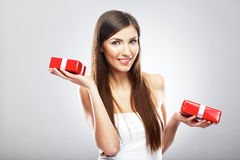 Smiling woman hold Christmass gift. Young beautiful model Stock Photography