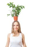 Smiling woman hold houseplant isolated on white. Stock Photos